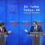 Turkish Prime Minister Ahmet Davutoglu (L) and European Council President Donald Tusk attend a news conference after a EU-Turkey summit in Brussels, Belgium November 29, 2015. REUTERS/Yves Herman
